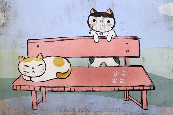 Cats on the bench. Chinese cats having a rest